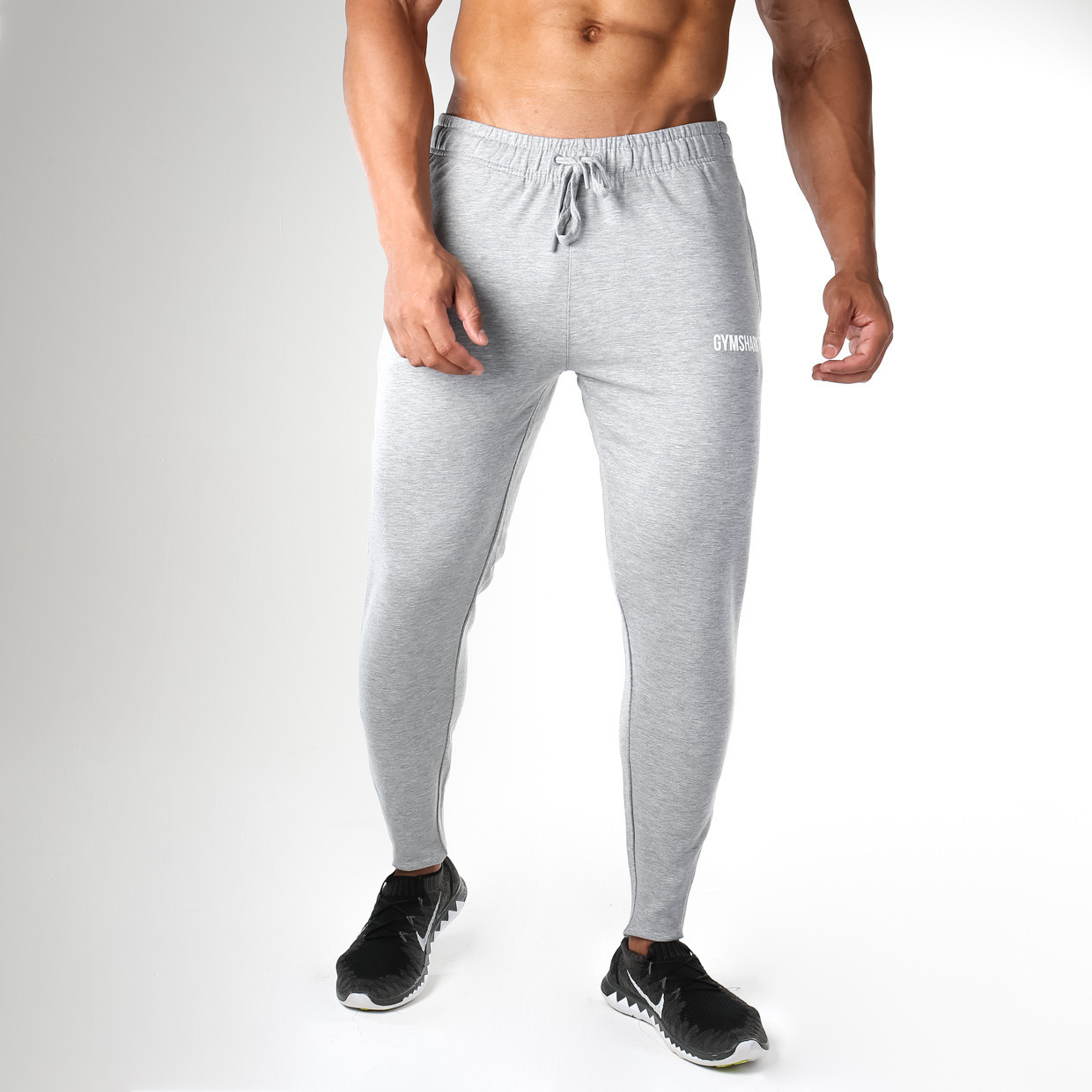 Gymshark Fit Tapered Bottoms in Light Grey